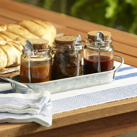 Galvanized Condiment Server   Adding charm to the mundane, this condiment set elevates entertaining. Set includes a convenient handled tray that lets you transport to the table or out to the patio with ease. Three small spoons make serving condiments and toppings simple while adding style.