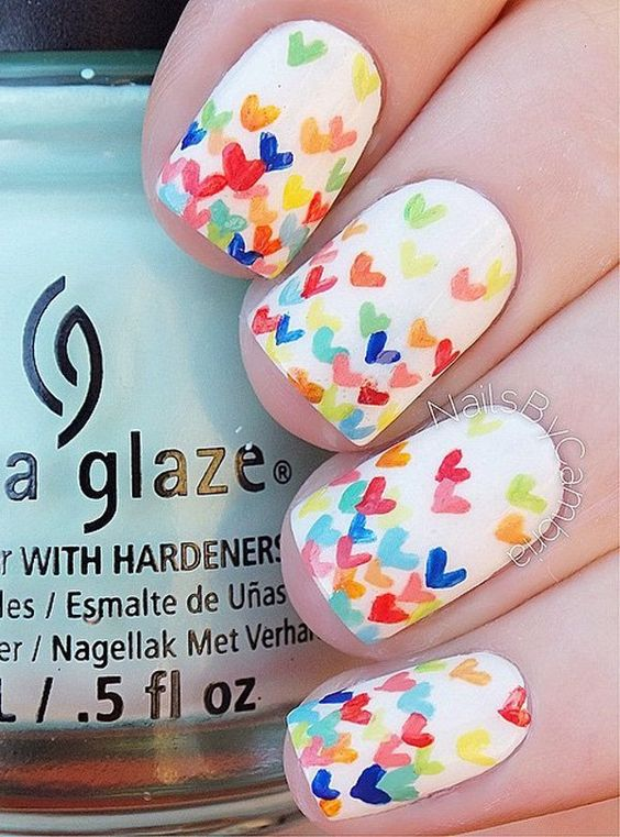 You can even create your own design if your up to DIY nail arts. Here's a simple hearts design on a white base to make the colors more distinct.