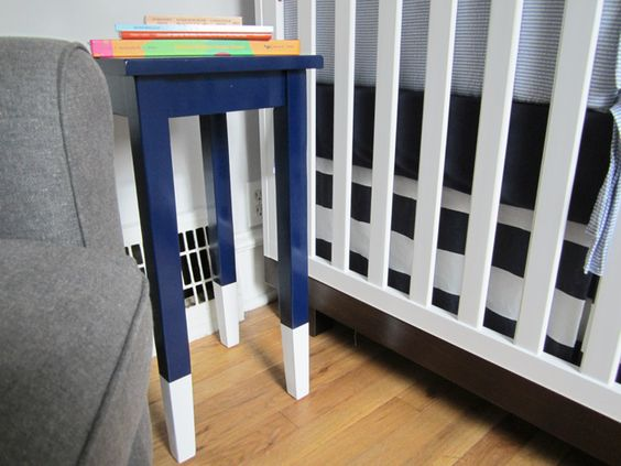 Easy DIY: Paint side table a fun color with glossy paint, then dip the legs in white (or contrasting color)! #DIY #nursery