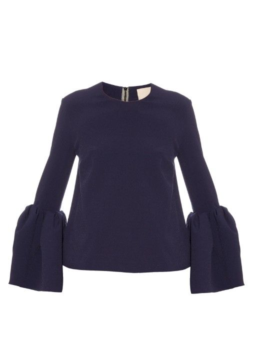 Roksanda's French-navy stretch bonded-crepe Traffaut top comes in one of the most coveted shapes of the season. It has a slim fit that's offset by the voluminous, bracelet-length bell sleeves. Enhance the proportions with a wide A-line skirt. | Available at MATCHESFASHION.COM