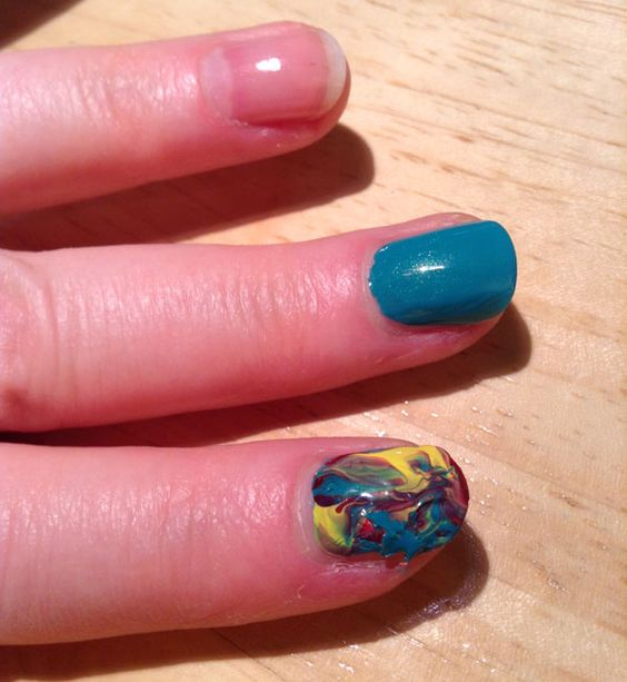 DIY nail strips with polish you have on hand. Used Saran Wrap -- next time use stiffer plastic.