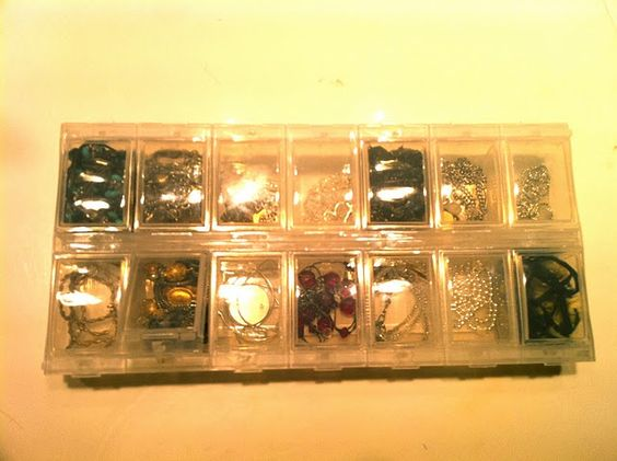 Use a pill organizer for storing necklaces & small earrings!: