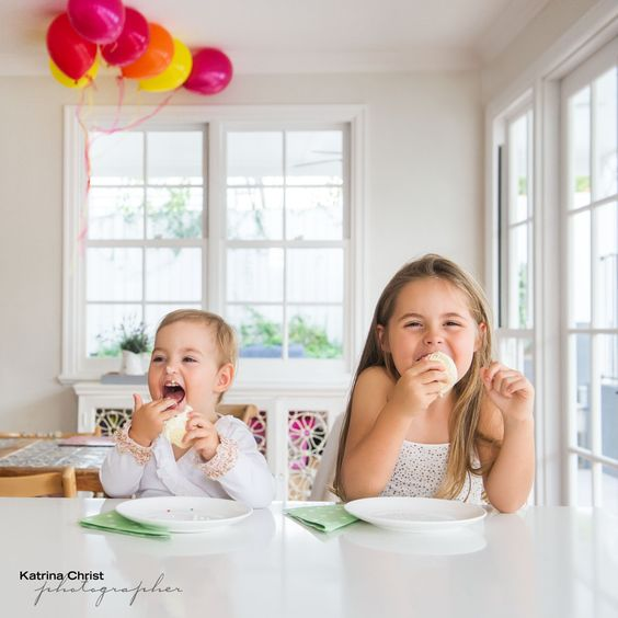 yeeehaarrrr , its the end of the photography sitting and its reward time. these girls having their own little party, so much fun photographing around your home, lots of little spots to shoot in. Fun Fun Fun  BRISBANE  http://www.katrinachrist.com.au/portrait-photo-gallery/Lifestyle-Collection/Childrens-Photographer.aspx