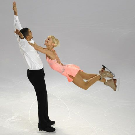 Pairs gold medalist Aliona Savchenko seems to float while holding onto partner Robin Szolkowy's neck at 2008 Skate America.
