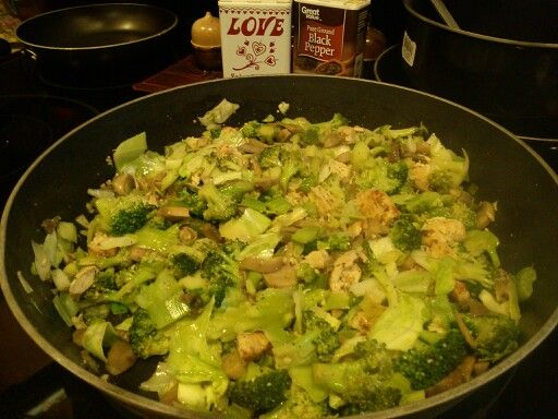 Cabbage stir fry with broccoli, mushrooms, onions, celery, grilled chicken pieces, pepper, salt, minced garlic, and olive oil.