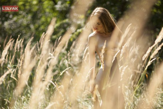 Love the nude-in-sunlit-field look.  We could do this with kick-arse lingerie.