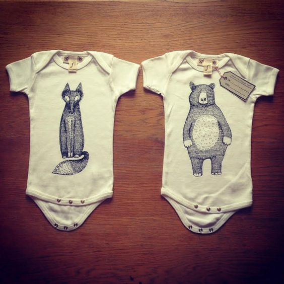 Lovely Organic hand screen printed Baby Grows/Body Suits. Made from ethical, fair trade cotton. Bear and T Rex designs available.