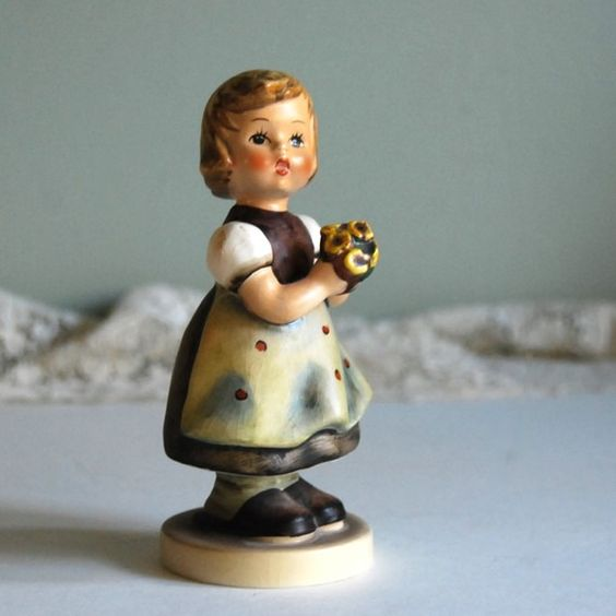 "This vintage Hummel figurine, ""For Mother"" was made in1963."