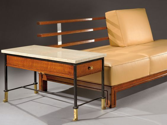 PAUL DUPRE-LAFON An exceptional, low, three place sofa in tinted oak with a backrest of horizontal metal rungs The seat and backrest are covered in beige leather, side tables in lacquered metal, bronze and oak with marble tops are placed on each side. Circa 1950. Sofa : H : 32 in L : 79 ½ in D : 38 in Tables : H : 19 2/3 in L 17 1/3 in D : 36 2/3 in