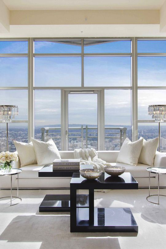 Inspiring Interiors: we're loving this bright and symmetrical penthouse suite in The Carlyle Residences in Los Angeles. Styled with our chic Luxe Crystal Floor Lamps and Solano Tables.