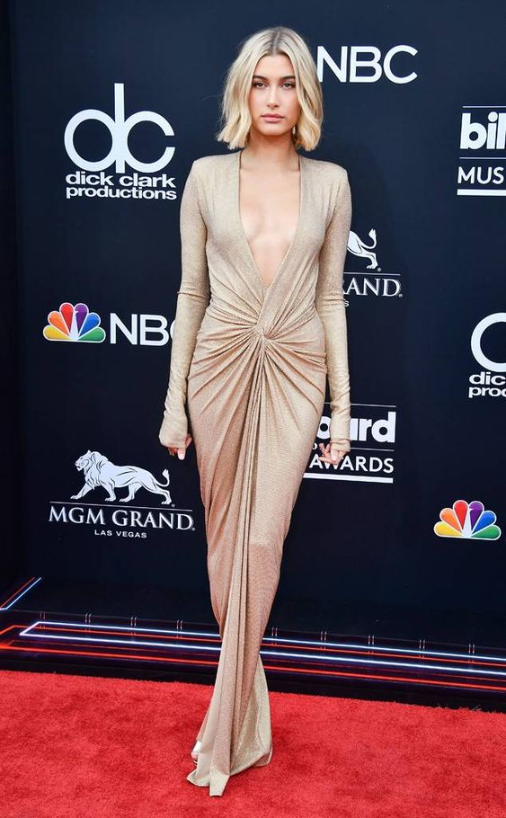 The supermodel rocks a plunging and golden dress for her first-ever trip to the award show.
