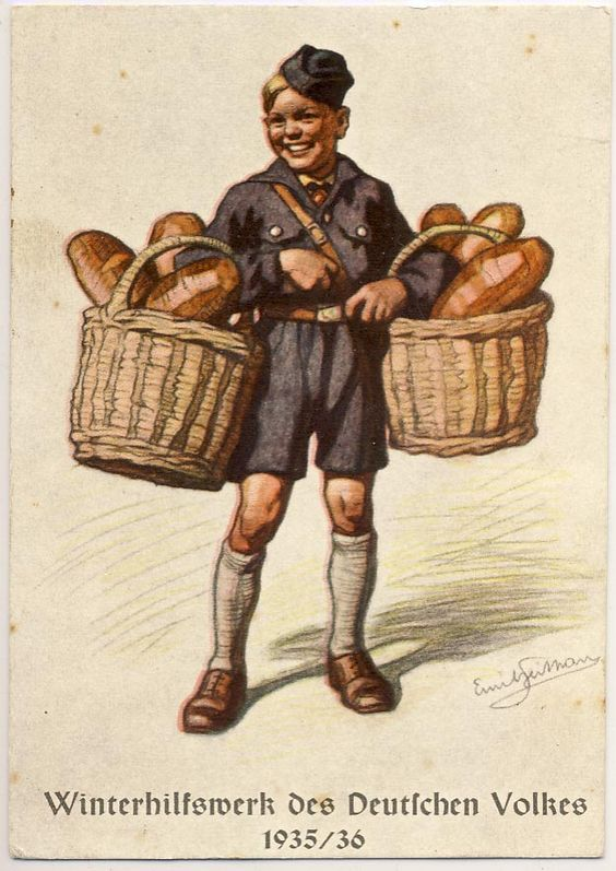 Hitler Jugend boy with bread baskets. Winterhilfswerk des Deutschen Volkes 1935/36