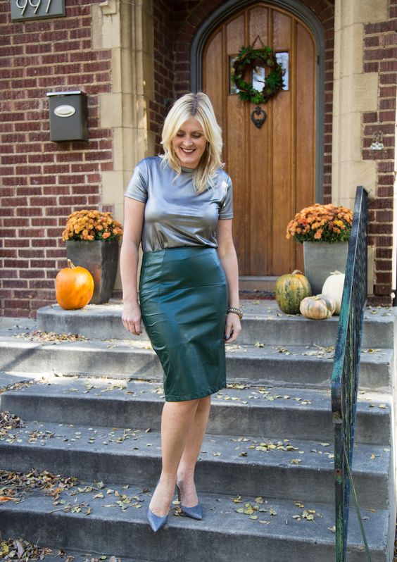 Full figure amateur model silver lamé top and green leather pencil skirt