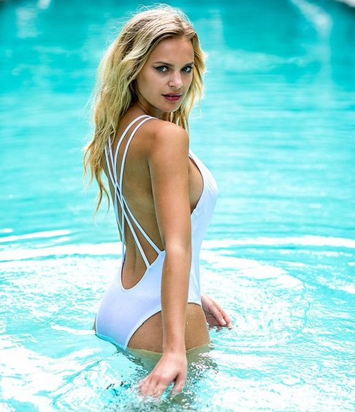 The double shoulder straps run criss cross down the open back. The skimpy backside coverage reminds everyone that one pieces are not only for the body conscious, but also for trendsetters and fashion forward fashionistas! #swimwear