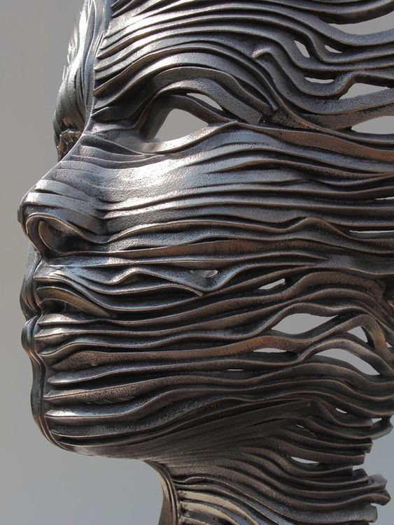 Texas-based sculptor Gil Bruvel manipulates ribbons of cast stainless steel to create spectacular figurative sculptures for his Flow series. Each form is e