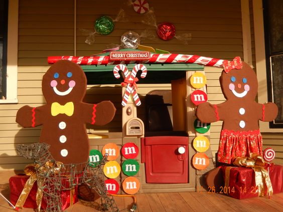 what do you do when the Little Tykes house can't leave the porch for Christmas?  Make it into a gingerbread house!  A little hot glue, a little foam, and a few bulletin board tacks help to make the transition.