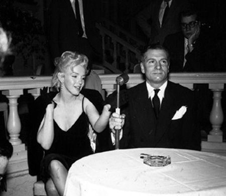 "Marilyn and Laurence Olivier at a press conference for ""The Prince and The Showgirl at the Plaza Hotel, New York. Photo by Milton Greene, February 9th 1956."