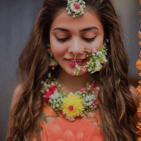 Love this Indian brides floral nath jewellery. #Frugal2Fab