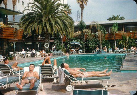 The Hollywood Roosevelt Pool, 1956. Where are all the women you ask? VLA member, Bas Elgharib informs us that women weren't allowed poolside, as it was deemed too distracting for all the men conducting business -but do they really seem to be conducting business? :)