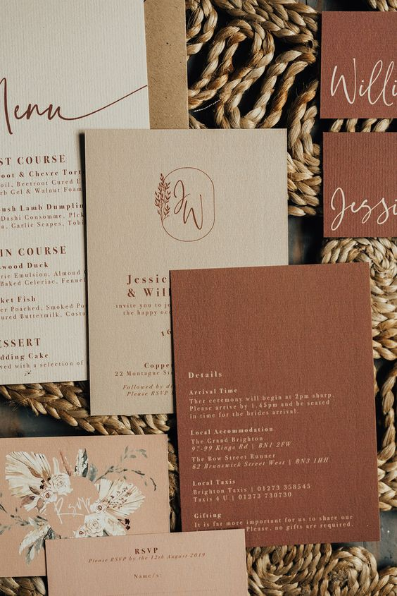 Modern bohemian wedding stationery with watercolour floral illustrations. Couple monogram. Wedding invitations. Boho wedding stationery. Natural rustic colours. Rustic wedding. Peach and tan wedding. Stationery by Wonderland Invites and shot by Rebecca Carpenter. #bohowedding #weddinginvitations #weddinginvites #weddingstationery