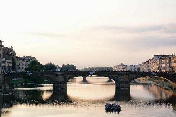 view of the Ponte Santa Trinita from the Ponte Vecchio in Florence, Italy - M and V Life So Far: