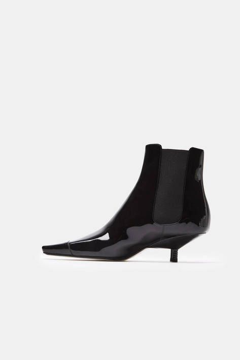 Under creative director Jonathan Anderson, the 170-year-old house of Loewe has started a new chapter, presenting itself to the world as multifaceted and dynamic while remaining true to its legacy of fine leathergoods. This glossy version of the Chelsea boot elevates the classic slip-on style with an inset kitten heel. Traced by seaming and tonal topstitching, the patent leather body has elasticated gussets and a squared-off toe.