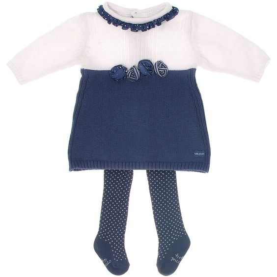 <span>Tutto Piccolo baby girls white and dark blue long sleeved knitted dress made from a soft cotton and angora mix with ribbed trims and buttons to fasten at the back for easy dressing. It has a gorgeous polka dot frill collar and pretty roses on the front, with matching polka dot tights, this makes an adorable little outfit.<br /></span> <ul> <li>Dress: 75% cotton, 20% polyamide,5% angora (soft knit)</li> <li>Tights: 80% cotton, 17% polyamide, 3% elastane</li> <li>Machine wash ...