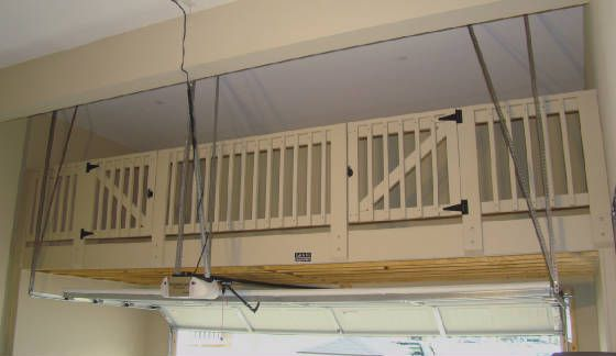 Garage loft with safety railing double access gates for Double garage with loft