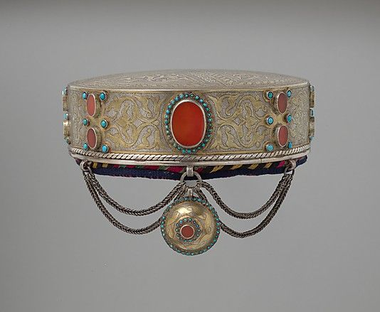 late 19th–early 20th century, Central Asia or Iran Culture: Islamic. Silver, fire-gilded and chased with wire chains, table cut carnelians and turquoise beads; quilted cotton lining