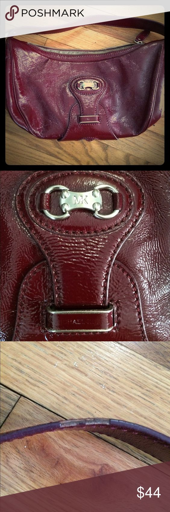 Michael Kors purse Beautiful burgundy Michael Kors purse. Good condition. The Michael Kors is worn off in the one spot, as you can see in the one picture. There is a small worn spot on the strap. Hardly noticeable, especially when worn. Michael Kors Bags Hobos