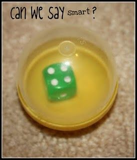 """dice in clear eggs allows the kids to shake the egg and """"roll"""" the dice.  No more dice flying off desks and clanking while being used."""