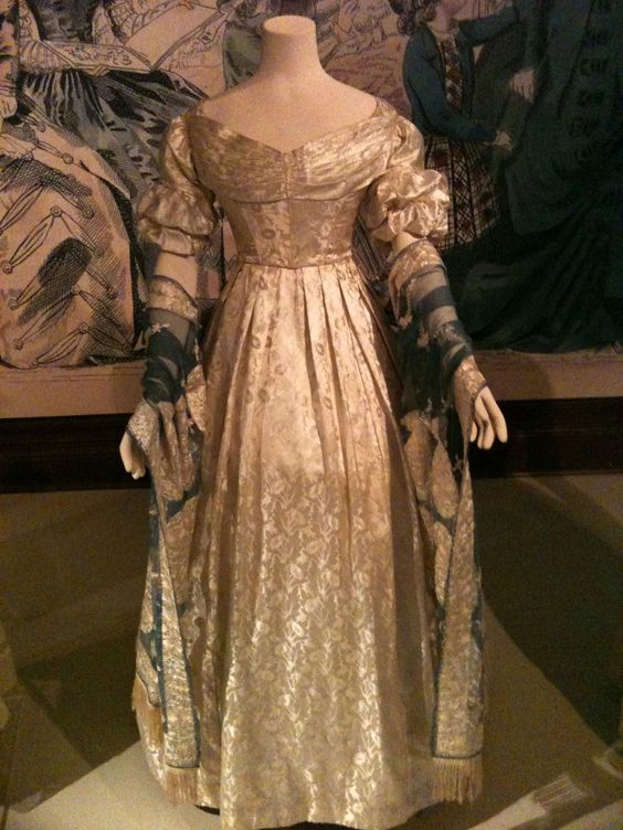 Evening dress of figured silk satin, c. 1836-1837, with evening stole of silk net and floss silk embroidery, c. 1820-1840, from Sudley House