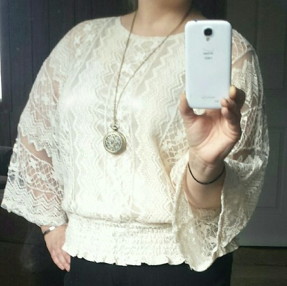 Beautiful Cream Lace Blouse Dress Barn size 14/16 flowy lace top. Excellent used condition.  It is sheer with a shiny white tank attached, so it's not see-through. Bat wing arms and cinched bottom.  I want to call it a crop top, but it's longer and stretchy. Dress Barn Tops Blouses