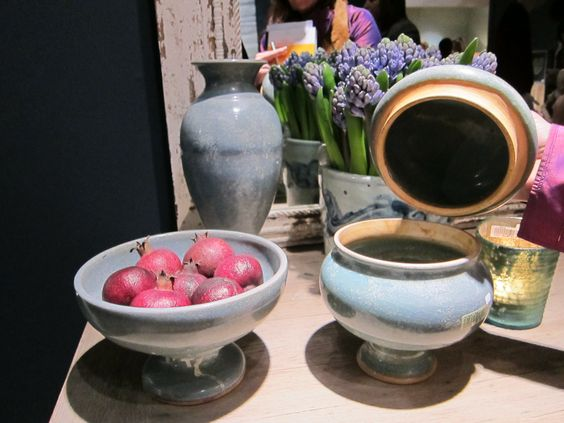 Ceramic pots and dishes in a soft blue hue.