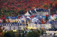 THIS IS THE FAIMONT TREMBLANT IN MONT TREMBLANT--QUEBEC ITS AT THE FOOT OF QUEBEC'S LAURENTIAN MOUNTAINS AND HAS VIEWS OF SNOW CAPPED MOUNTAINS IN THE WINTER AND THE CHANGE OF SEASONS IN THE FALL.