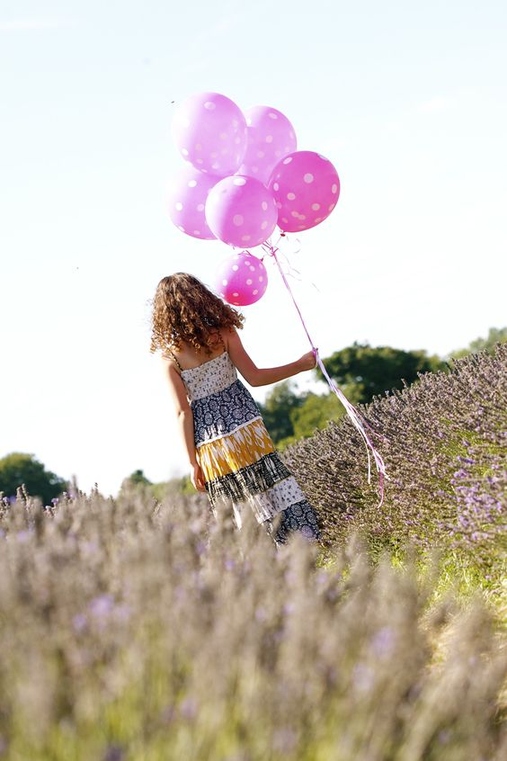 girl portrait with large balloons www.photographybytaraandclaire.com