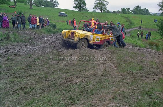 Spectators at the 1993 A.R.C. National Rally pushing a stuck Land Rover Series 2