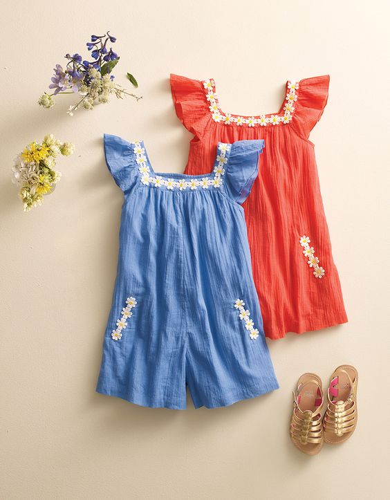 Is it a playsuit or a dress? Keep them guessing in this easy-to-wear and easier-to-love lightweight cotton one-piece.: