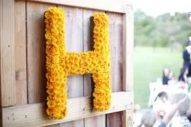 """cute cute - could easily make, using black-eyed susans or yellow button mums.  could do a """"L & C"""", too.  would be cute hanging on a window, on doors to chapel or reception, or standing up as a centerpiece on a table."""