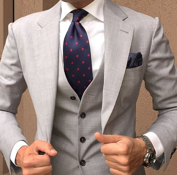 Blue dotted tie with white shirt