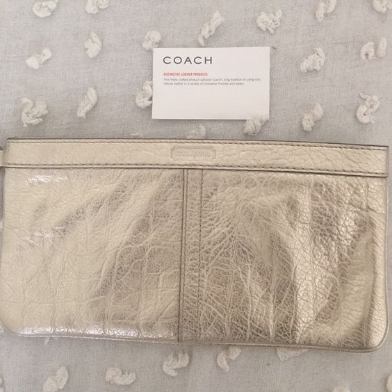 Coach Clutch ✨ Gold clutch from coach. Used once. Perfect for a wedding or night out. No strap. Coach Bags Clutches & Wristlets