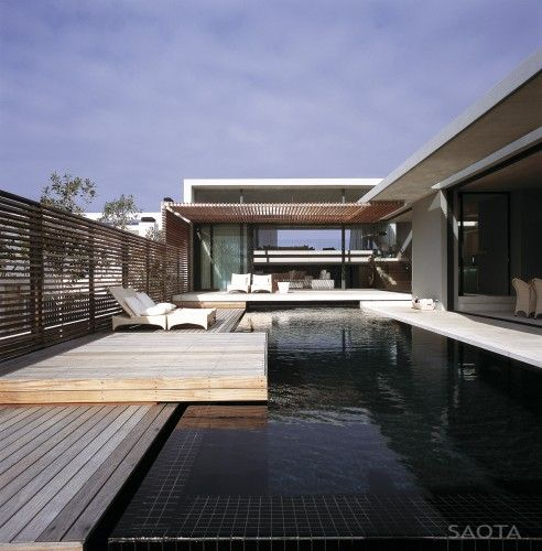 Sweeping use of materials... in this Beach House in South Africa.  By SAOTA.
