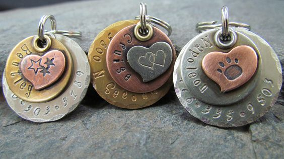 Dog tag - Pet tag - Pet Id Tag- Copper Nickel/Silver Brass with Copper or Nickel Heart- Hand stamped Engraved Personalized by themadstampers on Etsy https://www.etsy.com/listing/104008183/dog-tag-pet-tag-pet-id-tag-copper