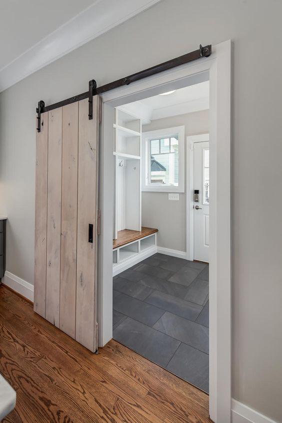 Classic Cottages Sliding Barn Door Leads Into Slate Flooring Mud Room Slate Flooring Sliding Barn Door Bathroom Interior Barn Doors