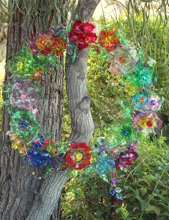 Glitterpooh discarded water bottles transformed into for Recycled flower art