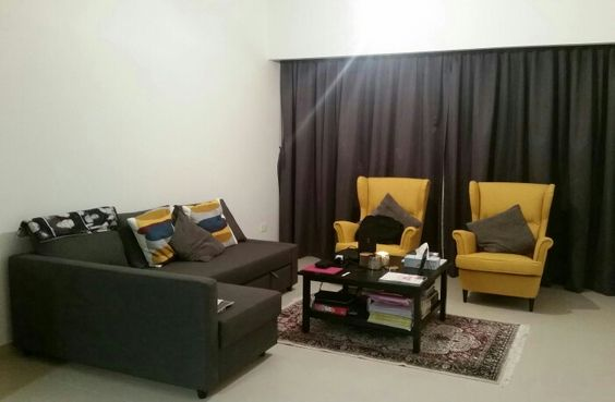 Yellow and Grey Lounge with persian carpet