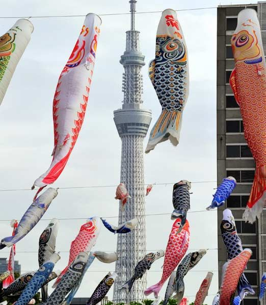 Some 450 colorful carp streamers fly before the world's highest radio tower, the Tokyo Sky Tree at a Tokyo park on May 2, 2012.