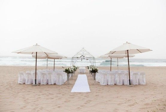 Beach wedding chairs and umbrellas