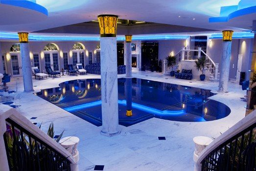 This magnificent roman style indoor pool features laminar for Roman style pool design