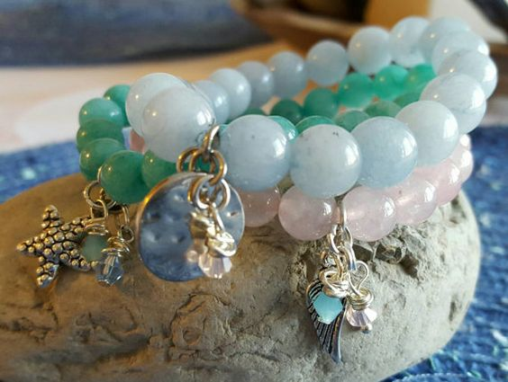 Add some color to your stack of bracelets with this gorgeous light blue 8mm bead bracelet!!! Accented with the latest trends!! Charms- Silver tone disc and light blue and pink crystals